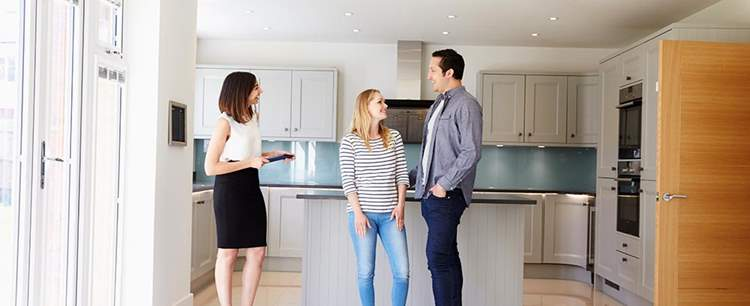 Realtor Showing Young Couple Around Property For S PDHK2DX